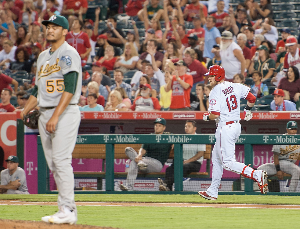 The Angels' Jett Bandy watches his two-run home run leave the park as he rounds the bases behind Oakland starter Sean Manaea in the fifth inning against the Oakland Athletics at Angel Stadium on Tuesday.<br /> <br /> ///ADDITIONAL INFO:   <br /> <br /> angels.0803.kjs  ---  Photo by KEVIN SULLIVAN / Orange County Register  -- 8/2/16<br /> <br /> The Los Angeles Angels take on the Oakland Athletics at Angel Stadium.