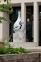 Bouke de Vries with  his sculpture in the Japanese garden of the UCL Student Centre, Gordon Street,London,UK.
