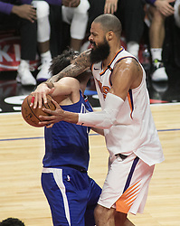 October 21, 2017 - Los Angeles, California, U.S - Milos Teodosic #4 of the Los Angeles Clippers is fouled by Tyson Chandler #4 of  the Phoenix Suns during their first season game on Saturday October 21, 2017 at the Staples Center in Los Angeles, California. Clippers defeat Suns, 130-88. (Credit Image: © Prensa Internacional via ZUMA Wire)