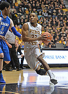 WICHITA, KS - JANUARY 18:  Guard Tekele Cotton #32 of the Wichita State Shockers drives to the basket against the Indiana State Sycamores during the first half on January 18, 2014 at Charles Koch Arena in Wichita, Kansas.  (Photo by Peter G. Aiken/Getty Images) *** Local Caption *** Tekele Cotton