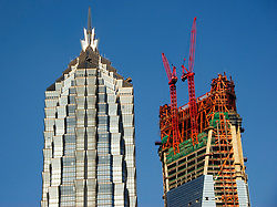 Construction of skyscrapers in Shanghai; JinMao Tower on the left