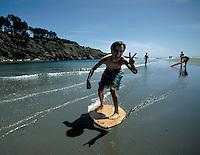 Skim boarding at Big River Beach near Mendocino, California