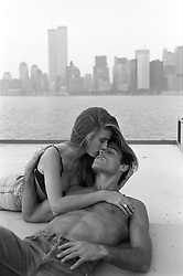 Couple on a ferry boat with The World Trade Center in the background