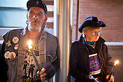 "04 JANUARY 2012 - PHOENIX, AZ:     People at a vigil for Marty Atencio in front of the Maricopa County Jail in Phoenix on January 4. Atencio died in a Phoenix hospital on Dec 20, 2011. He was arrested by Phoenix police a few days earlier after he exhibited ""bizarre"" behavior on the street. He was booked into the Maricopa County Jail. During the booking process he was tackled by Maricopa County Detention Officers and repeatedly hit was a Taser stun gun. He was later found unconscious in a holding cell and transferred to a hospital, where he died four days later. An autopsy showed no signs of illegal drugs or intoxication and a video from the jail showed that Atencio was not violent in the jail. His family has hired a lawyer and may sue the Maricopa County Sheriff's Department, which administers the jail.  PHOTO BY JACK KURTZ"