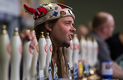 Olympia, London, August 9th 2015. Hundreds of real ale lovers attend the Campaign for Real Ale  Great British Beer Festival at London's Olympia Exhibition Centre, where dozens of independent breweries demonstrate the diversity of British brewed beers. PICTURED: Dozens of beer pumps around the venue distribute scores of different British brewed beers.
