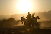 Horseback riding at sunset Photographed in the Aravah Desert, Israel