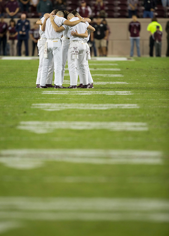 The Texas A&M Yell Leaders gather new mid field before the start of an NCAA college football game between New Mexico and Texas A&M on Saturday, Nov. 11, 2017, in College Station, Texas. (AP Photo/Sam Craft)