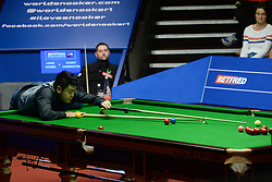 Liang Wenbo at the table in his match against Stuart Carrington on day four of the Betfred Snooker World Championships at the Crucible Theatre, Sheffield.