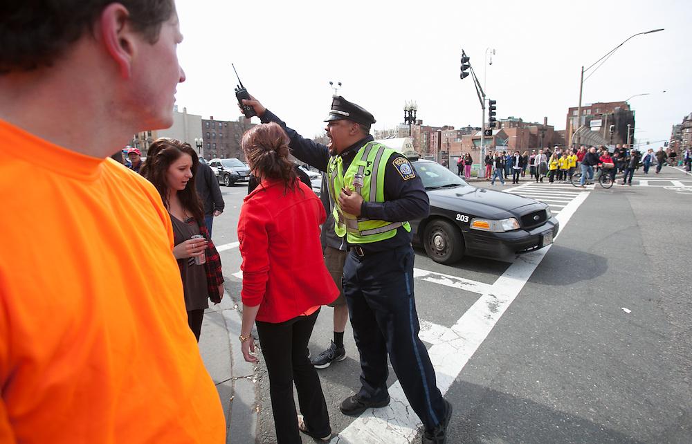 Boston, MA 04/15/2013.Boston Police officers turn pedestrians away from Boylston Street after two explosions at the finish of the Boston Marathon on Monday..Alex Jones / www.alexjonesphoto.com