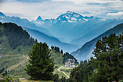 The majestic Weisshorn (4506 m / 14,783 feet) rises behind Berghotel Riederfurka, in Switzerland, the Alps, Europe. Riederfurka is perched between the Rhone valley and Aletsch Glacier. Getting there: near Brig, go to Mörel; take the aerial cable-car from Mörel via Ried to Riederalp summit station; then walk 20 minutes up to Riederfurka. A stunning ridge walk from Riderfurke gives vast views of Aletsch Glacier via Hohfluh, Moosfluh, Hohbalm; from Fiesheralp, lift up to the spectacular Eggishorn viewpoint. Grosser Aletschgletscher is the largest glacier in the Alps (23 km or 14 miles long in 2014). The Swiss Alps Jungfrau-Aletsch region is honored as a UNESCO World Heritage Site.