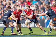 Chris Farrell (#13) of Munster Rugby runs at the Edinburgh defence during the Heineken Champions Cup quarter-final match between Edinburgh Rugby and Munster Rugby at BT Murrayfield Stadium, Edinburgh, Scotland on 30 March 2019.