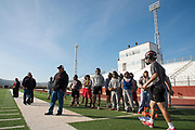 Iraan High School football coach Mark Kirchhoff talks with his team during their final walkthrough before getting on the busses to Arlington for their state title game in Iraan, Texas on December 14, 2016. (Cooper Neill for The New York Times)
