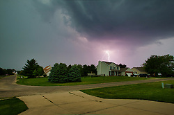 Lightning strikes for a July thunderstorm in Central Illinois produced by the heat convection of the humid day.