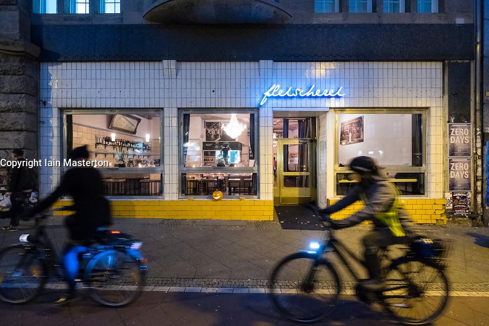 Exterior of Fleischerei restaurant at night in Prenzlauer Berg in Berlin Germany