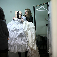 Miri Beillin, an ultra orthodox Jewish woman, dresses up a model as she works as a stylist during a fashion show for ultra orthodox women.