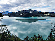 It is rare to find a windless day in southern Patagonia. Here the still waters of Lago Grey serve up a nice reflection of a cloudy sky. Lago Grey is in Torres del Paine National Park, Chile.