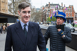 © Licensed to London News Pictures. 27/03/2019. London, UK. Brexit supporter Jacob Rees-Mogg (L), who has announced he may be able to support Prime Minister Theresa May's Brexit Deal, is asked questions by anti-Brexit protester Steve Bray in Westminster. MPs will hold a series of indicative votes on different Brexit options this evening. Photo credit: Rob Pinney/LNP