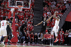 20 March 2017:  MiKyle McIntosh(11) shoots over A.J. Davis during a College NIT (National Invitational Tournament) 2nd round mens basketball game between the UCF (University of Central Florida) Knights and Illinois State Redbirds in  Redbird Arena, Normal IL