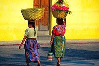 Women carrying flowers to market, Antigua Guatemala, Guatemala