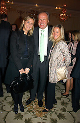 Left to right, the HON.MRS MONTGOMERY and  JUSTIN & MICHELLE CADBURY at a party to celebrate the launch of The Business - London's First Global Business Magazine held at the Mandarin Oriental Hyde Park, 66 Knightsbridge, London on 11th October 2006.<br />