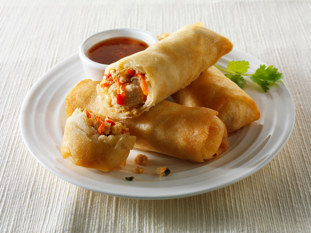 Oriental spring rolls filled with chicken &b vegetables with a chilli dipping sauce