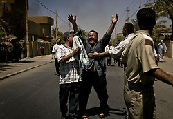 A man grieves in Baghdad, Iraq on Aug. 20, 2003. The previous day a cement truck packed with explosives detonated outside the offices of the UN headquarters in Baghdad, Iraq, killing 20 people and devastating the facility in an unprecedented suicide attack against the world body. At least 100 people were wounded.