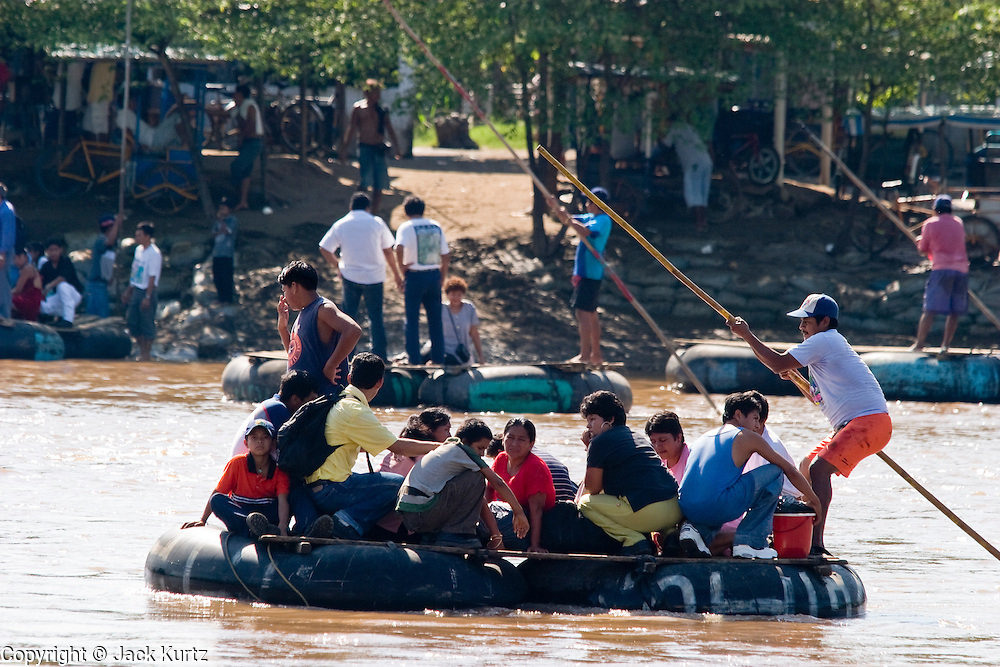 26 JULY 2004 -- TAPACHULA, CHIAPAS, MEXICO: A raft operator (balsero) brings people from Guatemala to Mexico near Tapachula, Mexico. Tapachula is center of the smuggling industry between Mexico and Guatemala. Consumer goods are smuggled south to Guatemala (to avoid paying Guatemalan import duties) and people are smuggled north into Mexico. Most of the people coming north are hoping to eventually get to the United States.  PHOTO BY JACK KURTZ