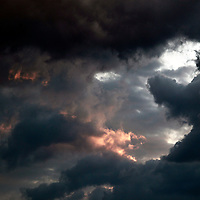 Africa, Botswana, Savute. Rain clouds and light in the skies over Chobe indicate the first rains of the season.