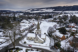 © Licensed to London News Pictures. 24/01/2021. Brockham, UK. Snow surrounds Christ Church in the village of Brockham, Surrey. A band of snow is crossing the south east this morning as temperature remain just above freezing. Photo credit: Peter Macdiarmid/LNP