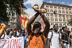 June 16, 2018 - Rome, Italy - Demonstrators protest during a march 'Prima gli sfruttati' ('Exploited people first') organized by Italy's USB (Base Union of Trade Unions) against the murder of the USB syndicalist Soumaila Sacko and the refusal by Italy to except migrants rescued at sea earlier in the week to land in the country, on June 16, 2018, in Rome. (Credit Image: © Jacopo Landi/NurPhoto via ZUMA Press)