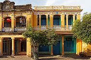 Unique colorful facades of French colonial buildings in Hoi An built along a small lane, Vietnam, Southeast Asia.