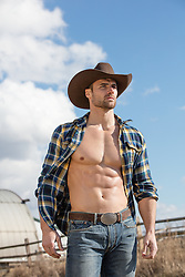 muscular cowboy with an open shirt