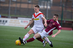 Airdrie's Chris O'Neil and Stenhousemuir's Sean Dickson. half time : Stenhousemuir 0 v 0 Airdrie, Scottish Football League Division One played 26/1/2019 at Ochilview Park.