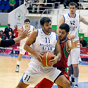 Anadolu Efes's Cenk AKYOL (C) during their Turkey Cup Qualifying basketball second match Anadolu Efes between Pinar Karsiyaka at Aliaga Arena in Izmir, Turkey, Monday, October 10, 2011. Photo by TURKPIX