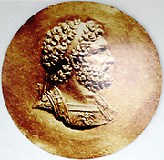 Philip II of Macedon (382-336 BC) father of Alexander the Great. This medallion shows left side of his face. Right side disfigured when struck in eye at siege of Methone in 354 BC. Archaeological Museum of Thessaloniki.