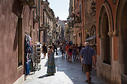 Tourists in street scene in the city of Taormina, East Sicily, Italy