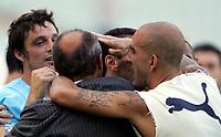 Fotball<br /> Serie A Italia<br /> Foto: Graffiti/Digitalsport<br /> NORWAY ONLY<br /> <br /> Roma 16/10/2005 <br /> <br /> Lazio v Fiorentina 1-0<br /> <br /> Massimo Oddo (L), Lazio trainer Delio Rossi (C) and Paolo Di Canio (R) celebrate after Zauri goal for Lazio