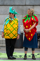 """© Licensed to London News Pictures. 04/09/2021. LONDON, UK.  Climate activists from Extinction Rebellion dressed as fruit protesting against HS2 take part in a March for Nature from Trafalgar Square to Marble Arch to highlight the effect of climate change on the loss of plant and animal life.  The event takes place on day thirteen of the two week 'Impossible Rebellion' protest to """"target the root cause of the climate and ecological crisis"""".  Photo credit: Stephen Chung/LNP"""