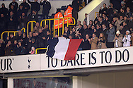National flag of France being waved whilst the national anthem of France is played out in a mark of respect to the Paris attacks before k/o. Barclays Premier league match, Tottenham Hotspur v West Ham Utd at White Hart Lane in London on Sunday 22nd November 2015.<br /> pic by John Patrick Fletcher, Andrew Orchard sports photography.