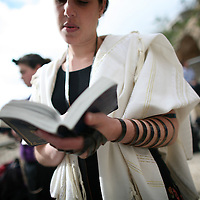 A Jewish woman of the Women of the Wall organization prays as she wears a phylacteries near the Western Wall Judiasm's holiest site in Jerusalem's Old City. Women of the Wall is a group of mostly religiously observant women who believe that women should be allowed to pray as a group at the Western Wall read from a Torah scroll and wear prayer shawls and phylacteries that in orthodox Judaism are used only by men.
