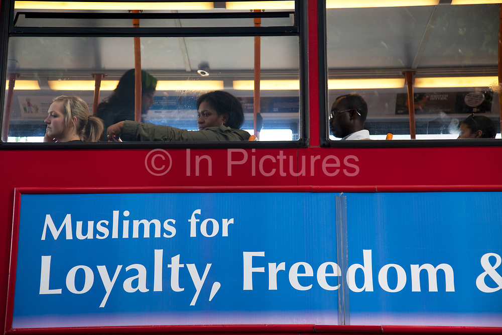 Sign on a bus which says 'Muslims for Loyalty, Freedom and Peace' in Stratford in East London. This is a relatively poor area of London, but in recent years has seen much regeneration, the construction of a major transport hub and various shopping complexes. Stratford is adjacent to the London Olympic Park and is currently experiencing regeneration and expansion linked to the 2012 Summer Olympics. (Photo by Mike Kemp/For The Washington Post)