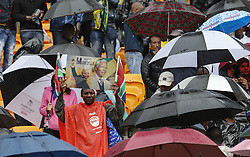 60813882 <br /> Supporters attend the memorial service for Nelson Mandela in Johannesburg, South Africa, on Dec. 10, 2013. Memorial service for former South African president Nelson Mandela started in Johannesburg on Tuesday as tens of thousands of mourners and more than 90 world leaders gather in rain to remember Mandela at memorial at the FNB Stadium in Soweto near Johannesburg, South Africa, Tuesday, 10th December 2013. Picture by  imago / i-Images<br /> <br /> UK ONLY