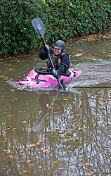 © Licensed to London News Pictures. 15/11/2020.  <br /> Yalding, UK. A canoeist enjoying a morning on the River Medway in Yalding, Kent. Over one hundred flood alerts are put in place by the Met Office today as the UK is hit with heavy overnight rain and gale force winds. Photo credit:Grant Falvey/LNP