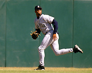 OAKLAND - 1988:  Ken Griffey Jr. of the Seattle Mariners fields during an MLB game against the Oakland Athletics at the Oakland-Alameda County Coliseum during the 1988 season. (Photo by Ron Vesely).  Subject:   Ken Griffey Jr.