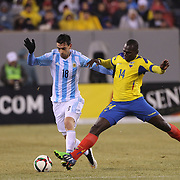 Javier Pastore, (left), Argentina, is challenged by Osbaldo Lastra, Ecuador, during the Argentina Vs Ecuador International friendly football match at MetLife Stadium, New Jersey. USA. 31st march 2015. Photo Tim Clayton