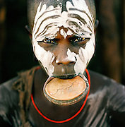 Mursi tribal woman with plate in lip, Omo Valley, Southern Ethiopia. The Mursi consider the lip plate as a form of beauty.