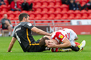 Doncaster Rovers forward John Marquis as he is fouled by Bradford city defender Ryan McGowan during the EFL Sky Bet League 1 match between Doncaster Rovers and Bradford City at the Keepmoat Stadium, Doncaster, England on 22 September 2018.