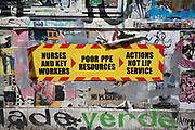 Highly politicised virus street art and graffiti in Shoreditch as lockdown continues and people observe the stay at home message in the capital on 12th May 2020 in London, England, United Kingdom. Coronavirus or Covid-19 is a new respiratory illness that has not previously been seen in humans. While much or Europe has been placed into lockdown, the UK government has now announced a slight relaxation of the stringent rules as part of their long term strategy, and in particular social distancing.