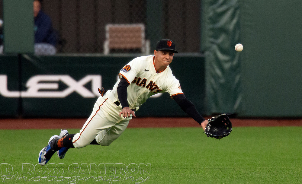 Sep 16, 2020; San Francisco, CA, USA; San Francisco Giants center fielder Mauricio Dubón (1) cannot make the catch of a sinking liner off the bat of Seattle Mariners Dylan Moore during the first inning of a baseball game at Oracle Park. Mandatory Credit: D. Ross Cameron-USA TODAY Sports