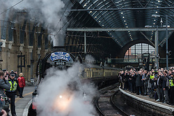 © Licensed to London News Pictures. 25/02/2016. London, England. The Flying Scotsman train pulls into London King's Cross station today on February 25 2016. The historic steam train is back on the tracks after a recent £4.2 million refit. Photo credit: Chris Ratcliffe/LNP